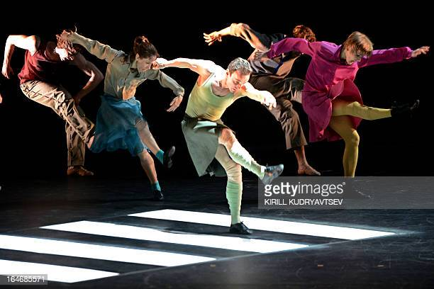 The Bolshoi ballet dancers perform during a rehearsal for a 'Appartment' by Sweden's choreographer Mats Ek at the Bolshoi Theatre in Moscow on March...