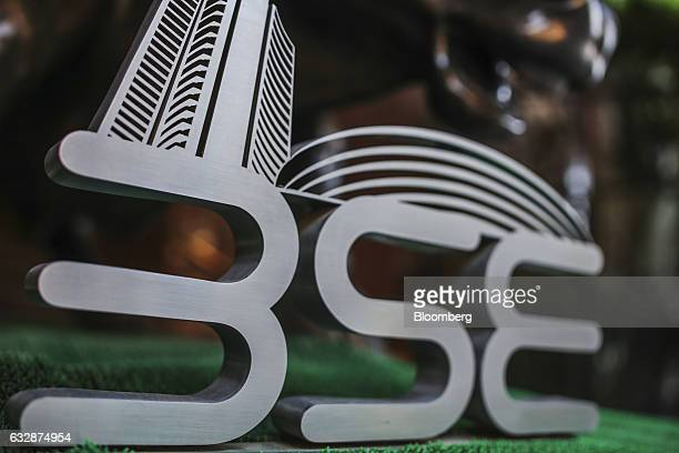The Bombay Stock Exchange logo sit on display inside the bourse in Mumbai India on Friday Jan 27 2017 While economists urge more investment in roads...
