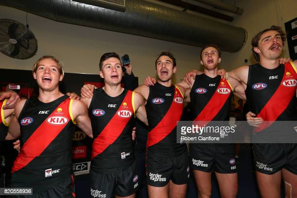 The Bombers celebrate after they defeated the Kangaroos during the round 18 AFL match between the Essendon Bombers and the North Melbourne Kangaroos...