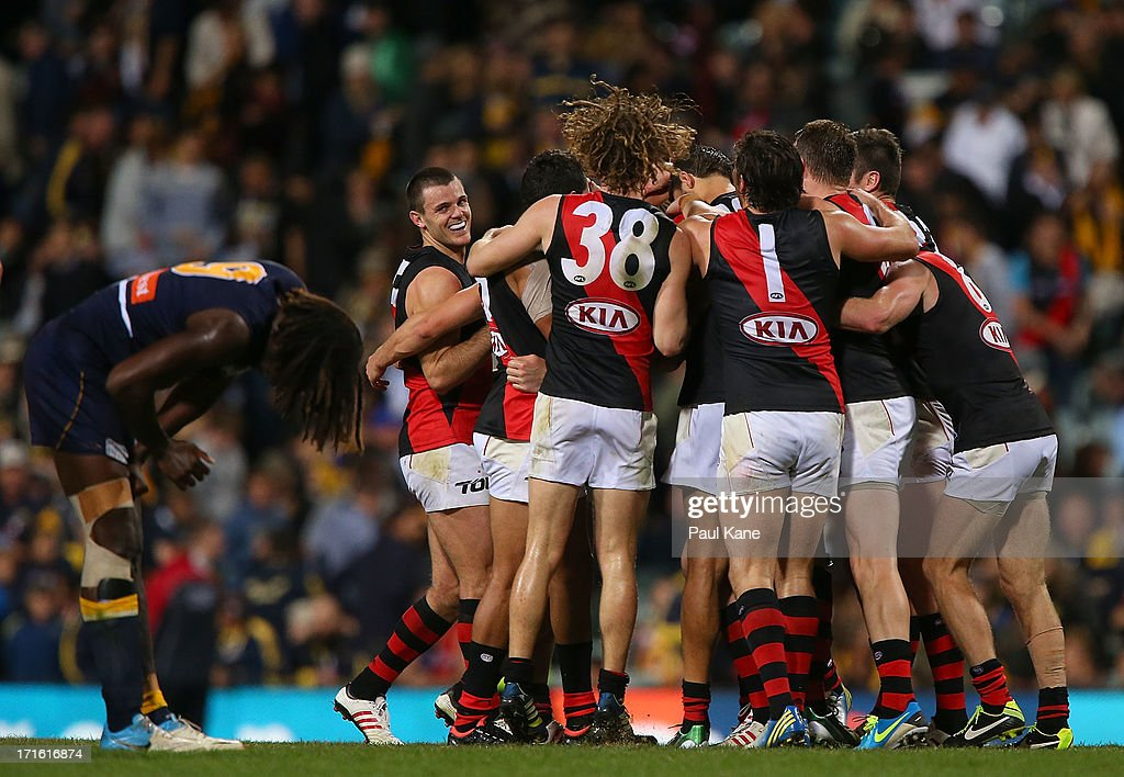The Bombers celebrate defeating the Eagles as Nic Naitanui looks dejected during the round 14 AFL match between the West Coast Eagles and the Essendon Bombers at Patersons Stadium on June 27, 2013 in Perth, Australia.