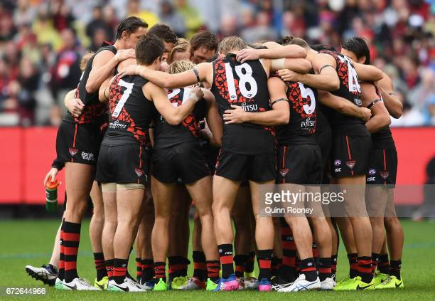 The Bombers huddle together during the round five AFL match between the Essendon Bombers and the Collingwood Magpies at Melbourne Cricket Ground on...