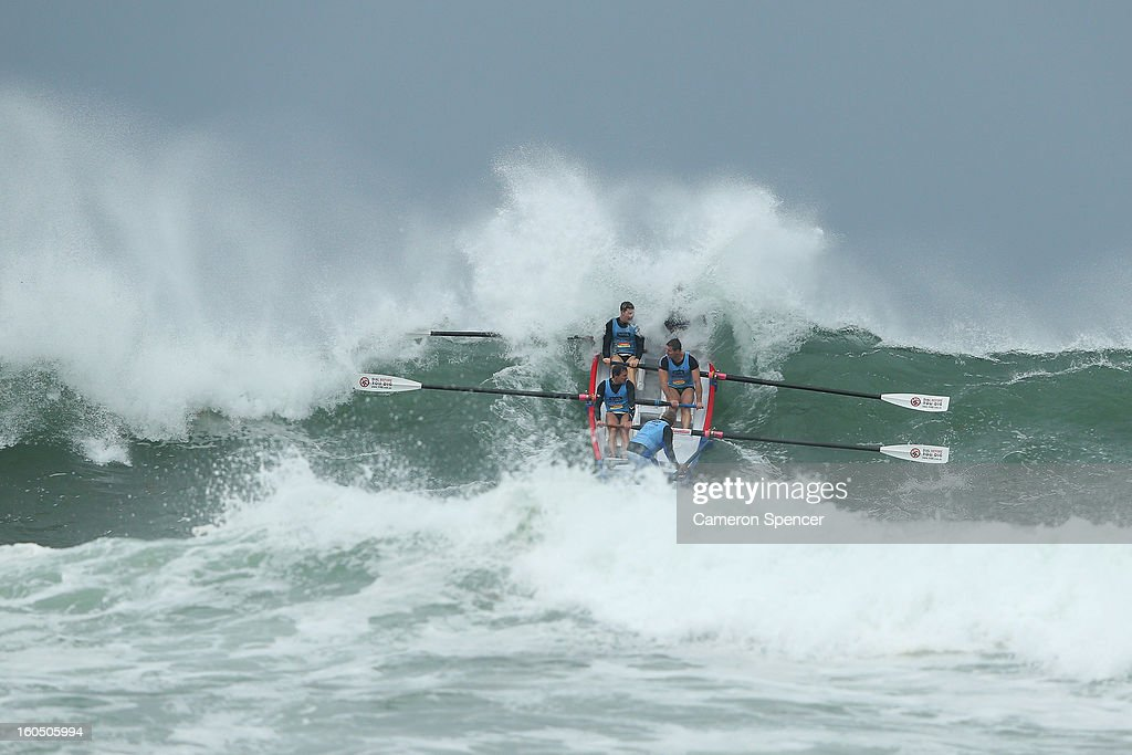 The Bondi suf life saving crew paddle through a wave during the Ocean Thunder Surf Boat Series at Dee Why Beach on February 2, 2013 in Sydney, Australia.