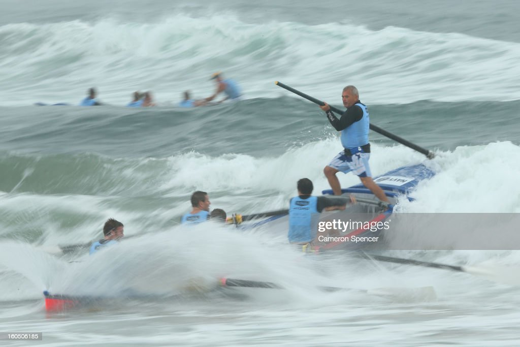 The Bondi suf life saving crew ride a wave during the Ocean Thunder Surf Boat Series at Dee Why Beach on February 2, 2013 in Sydney, Australia.