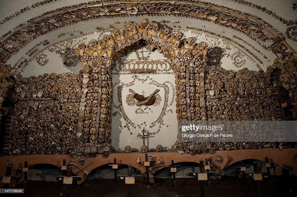 The bones of the Capuchin monks decorate the wall and the ceiling of the crypt, during the opening of the museum in the Capuchin convent of the Immaculate Conception of the Blessed Virgin Mary on June 26, 2012 in Rome, Italy. The monastery, which was first used by Capuchin monks and nuns in 1626, has become a destination for tourists from all over the world who visit an ossuary in the crypt which contains the skeletal remains of 3,700 monks.
