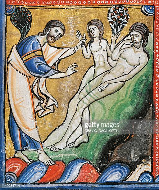 The Book of Genesis the creation of Eve from Adam's rib miniature from the Bible of Souvigny Latin manuscript 1 folio 4 verso 12th Century