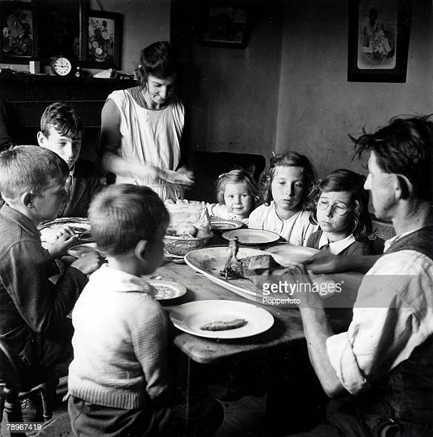 The Book Volume 1 PagePicture1941 Kent England A family sit around the table eating their dinner