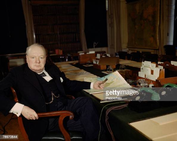 The Book Volume Page Picture World War II March A picture of British Prime Minister Winston Churchill pictured at his desk
