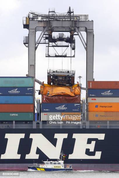 The boom of a dockside crane lies crumpled on top of containers aboard the NYK Themis at Southampton Container Terminal today