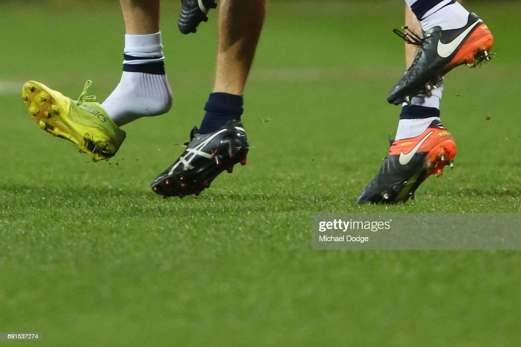 The boot of Daniel Menzel of the Cats flies off during a contest during the round 11 AFL match between the Geelong Cats and the Adelaide Crows at Simonds Stadium on June 2, 2017 in Geelong, Australia.