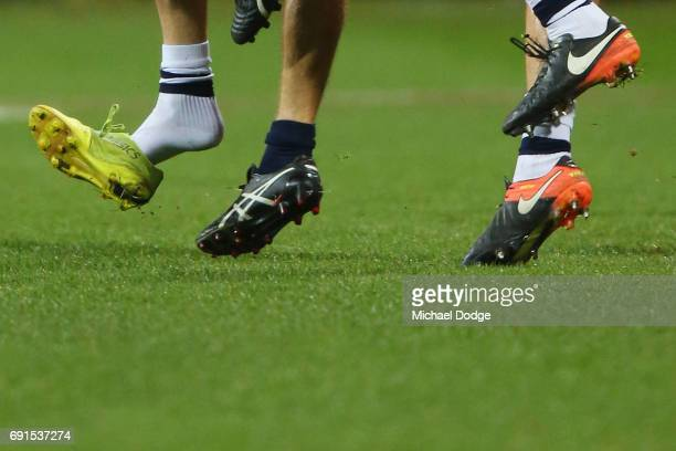 The boot of Daniel Menzel of the Cats flies off during a contest during the round 11 AFL match between the Geelong Cats and the Adelaide Crows at...