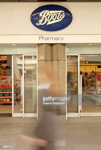 The Boots logo is seen outside a store March 27 2003 in London Twelve Boots Wellbeing health and beauty services outlets will be closed and six Pure...
