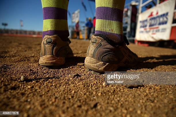 The boots of a bullfighter are seen as he waits for the gate to open in the Bull Ride Spectacular on the first day of the 2014 Deni Ute Muster at the...