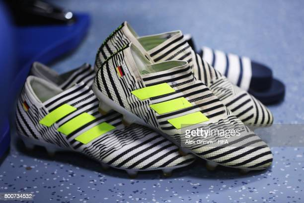 The boots of Julian Draxler of Germany are seen in the Germany changing room prior to the FIFA Confederations Cup Russia 2017 Group B match between...