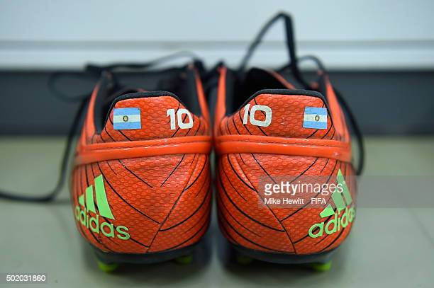 The boots of Lionel Messi are laid out in the Barcelona dressing room ahead of the FIFA Club World Cup Japan 2015 Final between River Plate and FC...