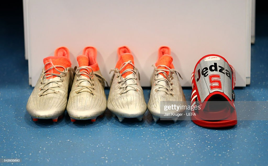 The boots worn a Poland player are seen in the dressing room prior to the UEFA EURO 2016 quarter final match between Poland and Portugal at Stade Velodrome on June 30, 2016 in Marseille, France.