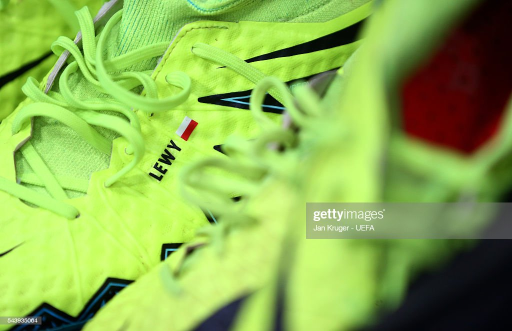 The boots worn by a Poland player are seen in the dressing room prior to the UEFA EURO 2016 quarter final match between Poland and Portugal at Stade Velodrome on June 30, 2016 in Marseille, France.