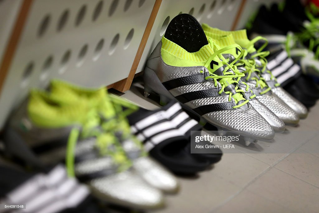 The boots worn by Wales players are seen in the dressing room prior to the UEFA EURO 2016 quarter final match between Wales and Belgium at Stade Pierre-Mauroy on July 1, 2016 in Lille, France.