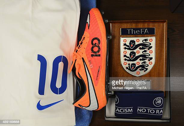 The boots worn by Wayne Rooney on his 100th cap together with the match pennant are displayed in the dressing room prior to the EURO 2016 Group E...