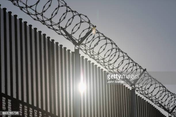 The border fence between the United States and Mexico stands at an international bridge between the two countries on March 14 2017 in Hidalgo Texas...