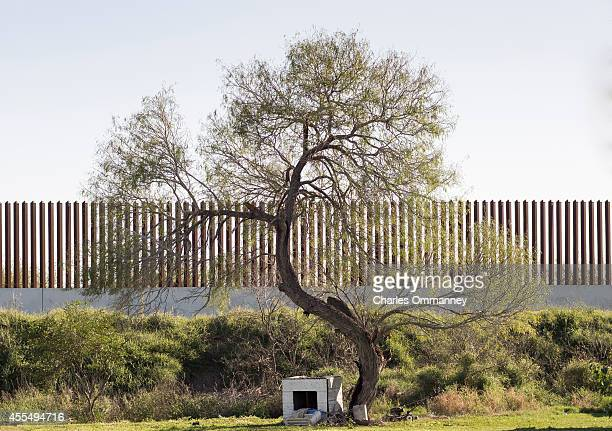 The border fence north of McAllen along the Texas/Mexico border in the Rio Grande Valley of Texas is seen January 15 2014