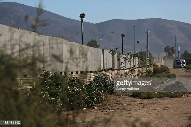 The border wall stands approximately 100 yards from a factory where a drug tunnel was discovered leading into the United States on October 31 2013 in...