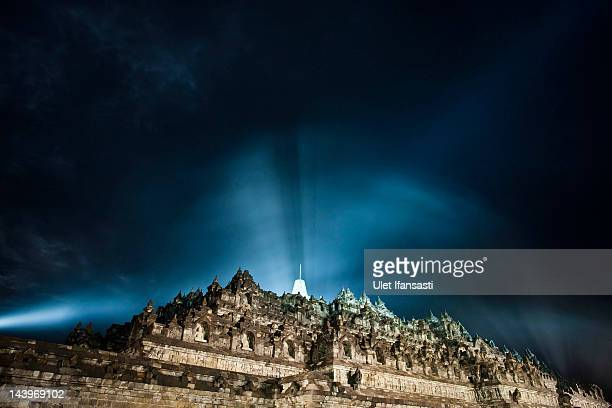 The Borobudur temple seen illuminated during Vesak Day commonly known as 'Buddha's birthday' at the Borobudur Mahayana Buddhist monument on May 6...