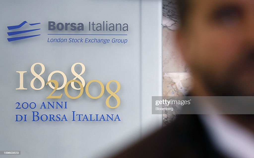 The Borsa Italiana logo sits on a sign inside Italy's stock exchange, which is part of the London Stock Exchange Group Plc, in Milan, Italy, on Thursday, Jan. 17, 2013. The euro-area economy won't return to growth until the next quarter as a recovery in Italy is delayed and France continues to shrink, according to a survey of economists. Photographer: Alessia Pierdomenico/Bloomberg via Getty Images