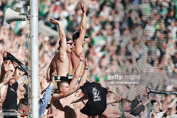 The Borussia Moenchengladbach fans celebrate after victory in the Bundesliga match between Borussia Moenchengladbach and Bayer 04 Leverkusen held at...