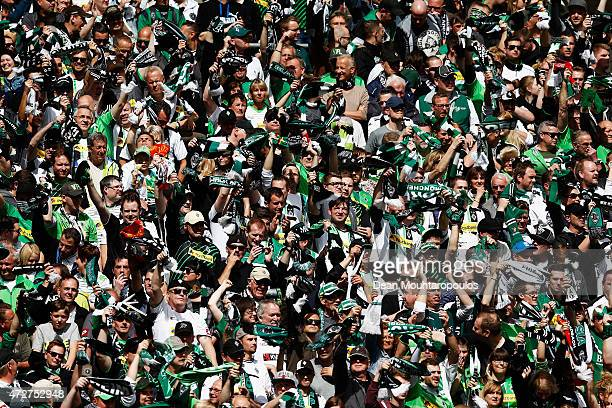 The Borussia Moenchengladbach fans cheer during the Bundesliga match between Borussia Moenchengladbach and Bayer 04 Leverkusen held at Borussia Park...