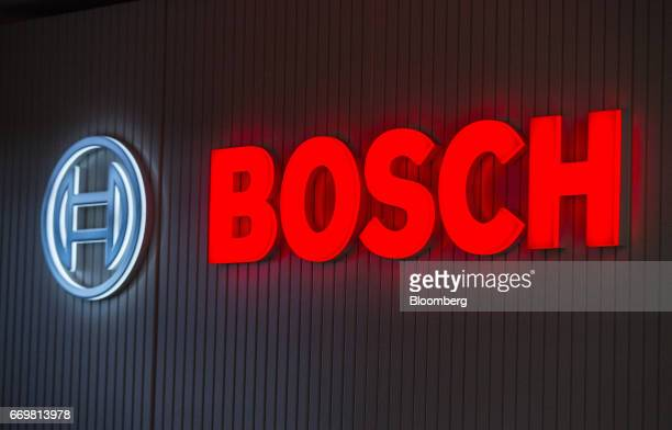 The Bosch logo sits illuminated on a wall at the Robert Bosch GmbH digital factory in Stuttgart Germany on Tuesday April 18 2017 The global...