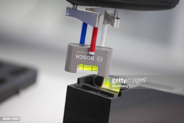 The Bosch logo sits on a spirit level as it is transported on an automated production line at the Robert Bosch GmbH digital factory in Stuttgart...