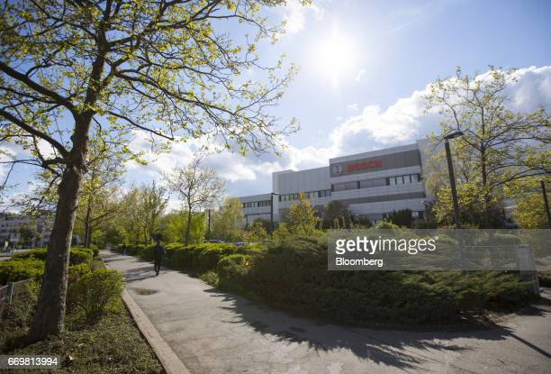 The Bosch logo sits on the Robert Bosch GmbH digital factory in Stuttgart Germany on Tuesday April 18 2017 The global manufacturing sector spent an...