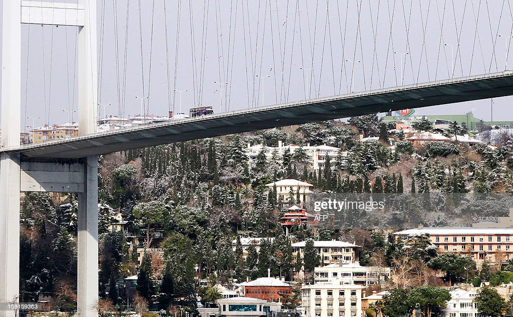 The Bosphorus bridge is pictured from the Anatolian side of Istanbul on January 9, 2013. Heavy snowfall blanketed Turkey's commercial hub Istanbul, a city of 15 millions, paralysing daily life, disrupting air traffic and land transport.