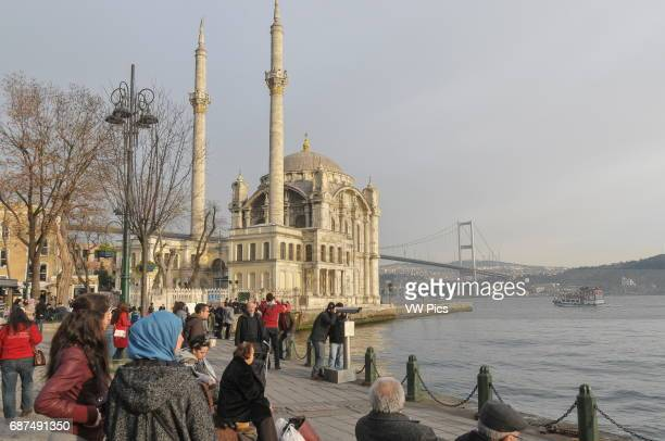 The Bosphorus seafront at Ortak_y on the European side of Istanbul In the background are Ortak_y mosque and the first Bosphorus bridge