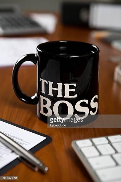 The Boss mug on a desk
