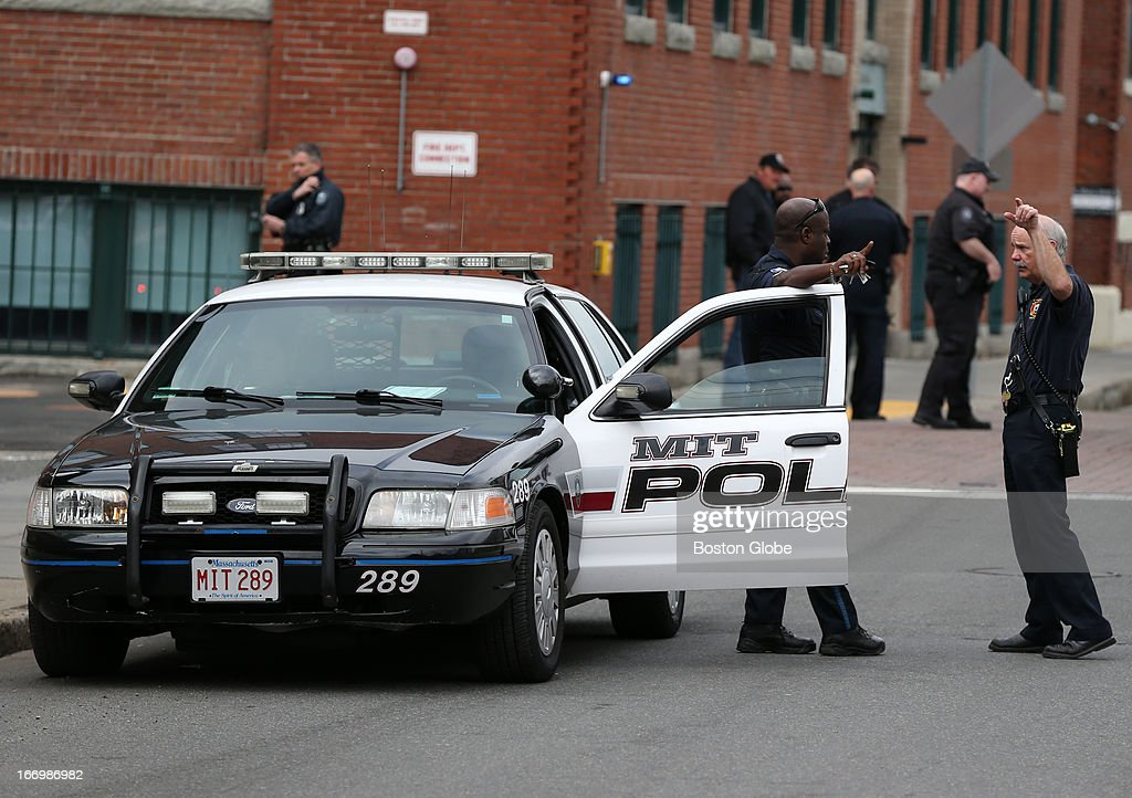 The Boston Area is under lockdown as Marathon suspects are sought. An MIT police officer and a Cambridge firefighter talk in Cambridge as the Boston area is under lockdown during the ongoing manhunt for a suspect in the terrorist bombing of the 117th Boston Marathon earlier this week.