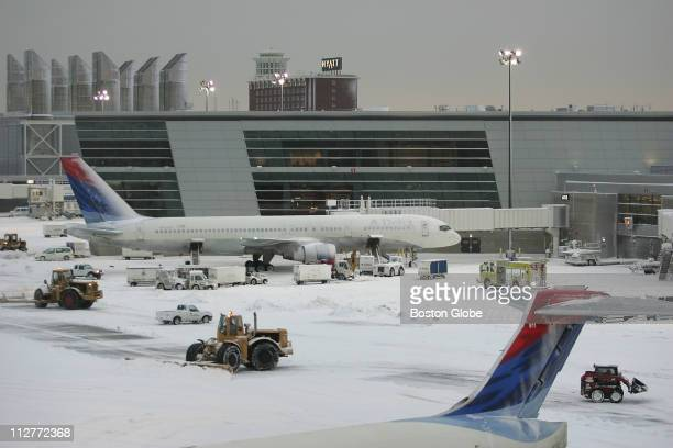 The Boston area was hammered by a midafternoon 'thundersnow' storm which caused major traffic delays and a wave of cancellations at Logan...