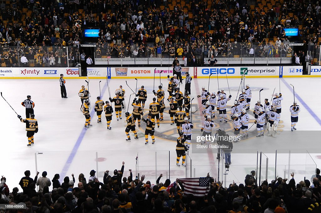 The Boston Bruins and the Buffalo Sabres raise their sticks in salute to the fans at the TD Garden on April 17, 2013 in Boston, Massachusetts.