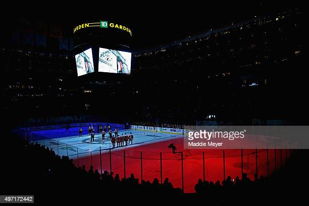 The Boston Bruins and the Detroit Red Wings pause for a moment of silece to honor the victims of the terrorist attacks in Paris on November 13 before...