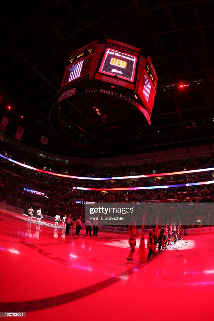 The Boston Bruins and the Florida Panthers line up on the ice for the national anthem prior to the start of the game at the BB&T Center on February 24, 2013 in Sunrise, Florida.