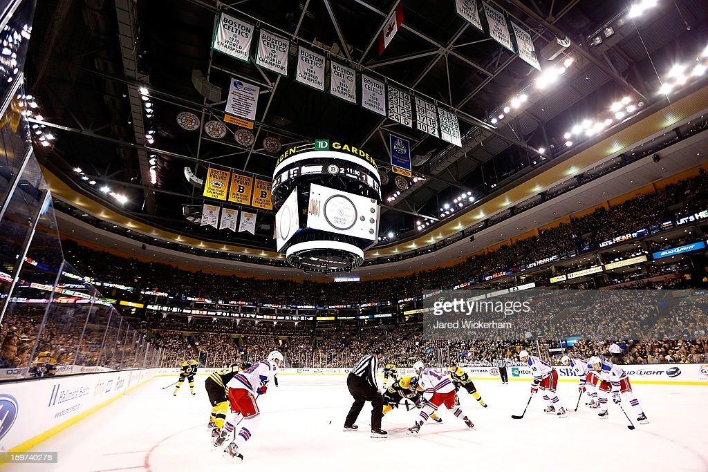 The Boston Bruins and the New York Rangers face off during the season opener game on January 19, 2013 at TD Garden in Boston, Massachusetts.