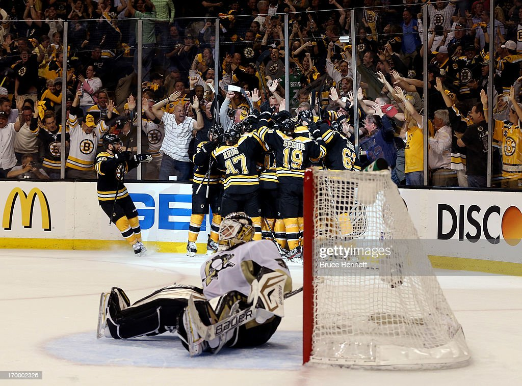 The Boston Bruins celebrate a double overtime victory, 2-1, over the Pittsburgh Penguins on a goal scored by <a gi-track='captionPersonalityLinkClicked' href=/galleries/search?phrase=Patrice+Bergeron&family=editorial&specificpeople=204162 ng-click='$event.stopPropagation()'>Patrice Bergeron</a> in Game Three of the Eastern Conference Final of the 2013 NHL Stanley Cup Playoffs at the TD Garden on June 5, 2013 in Boston, Massachusetts.
