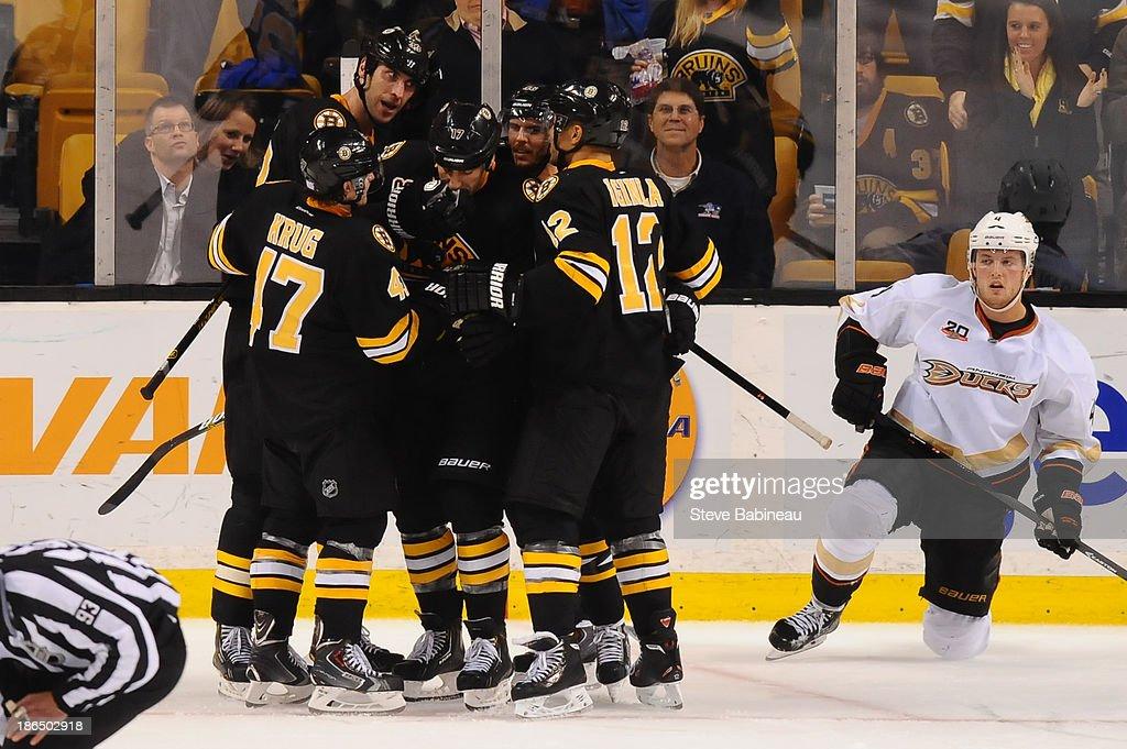The Boston Bruins celebrate a game-tying goal against the Anaheim Ducks at the TD Garden on October 31, 2013 in Boston, Massachusetts.