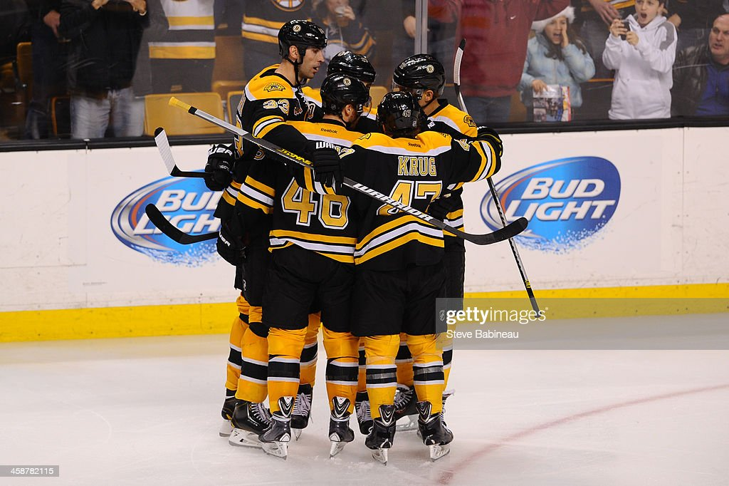 The Boston Bruins celebrate a goal against the Buffalo Sabres at the TD Garden on December 21, 2013 in Boston, Massachusetts.