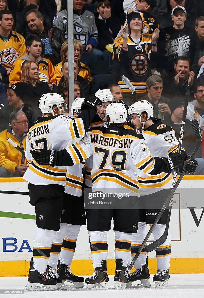 The Boston Bruins celebrate a goal against the Nashville Predators at Bridgestone Arena on December 23, 2013 in Nashville, Tennessee.