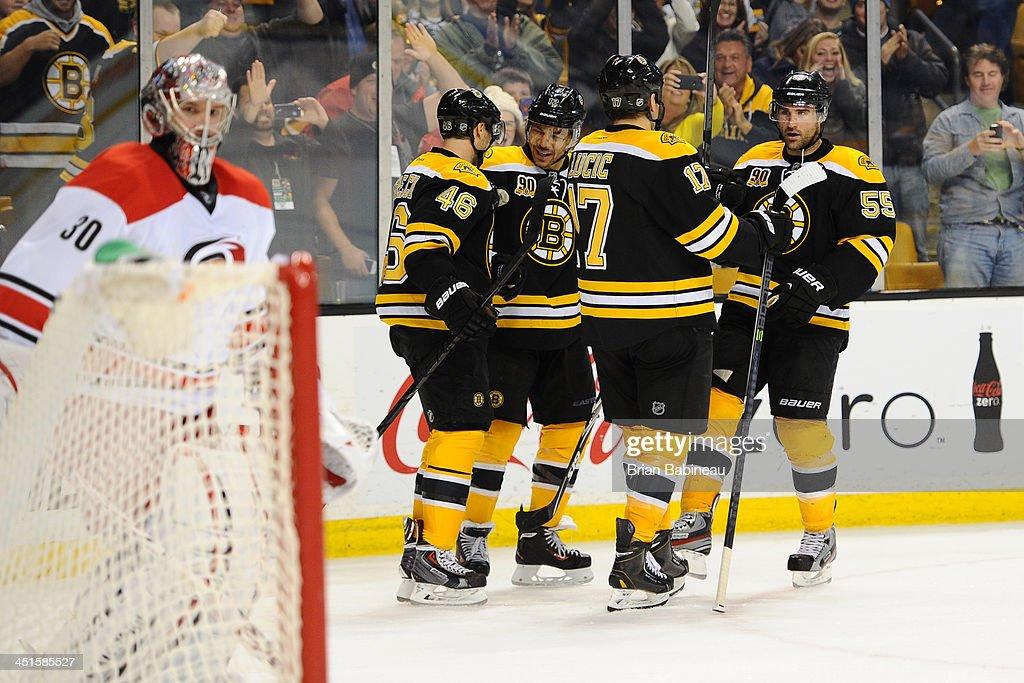 The Boston Bruins celebrate a goal in overtime against the Carolina Hurricanes at the TD Garden on November 23, 2013 in Boston, Massachusetts.