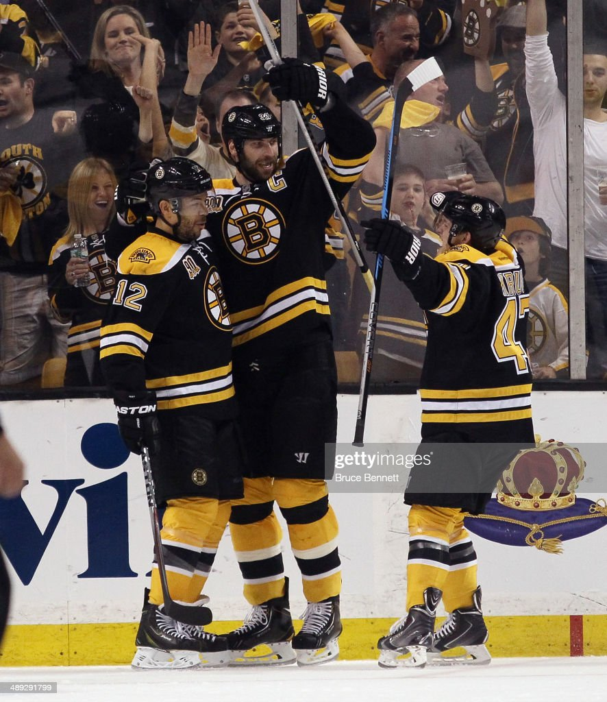 The Boston Bruins celebrate a powerplay goal by <a gi-track='captionPersonalityLinkClicked' href=/galleries/search?phrase=Jarome+Iginla&family=editorial&specificpeople=201792 ng-click='$event.stopPropagation()'>Jarome Iginla</a> #12 at 1:36 of the second period against the Montreal Canadiens during Game Five of the Second Round of the 2014 NHL Stanley Cup Playoffs at the TD Garden on May 10, 2014 in Boston, Massachusetts. Joined Iginla is <a gi-track='captionPersonalityLinkClicked' href=/galleries/search?phrase=Zdeno+Chara&family=editorial&specificpeople=203177 ng-click='$event.stopPropagation()'>Zdeno Chara</a> #33 (C) and <a gi-track='captionPersonalityLinkClicked' href=/galleries/search?phrase=Torey+Krug&family=editorial&specificpeople=6670036 ng-click='$event.stopPropagation()'>Torey Krug</a> #47 (R).