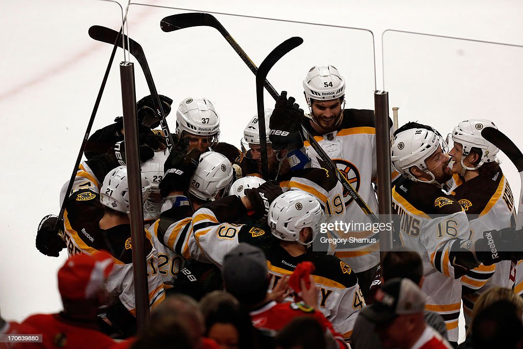 The Boston Bruins celebrate after Daniel Paille #20 scored the game-winning goal in overtime against the Chicago Blackhawks in Game Two of the NHL 2013 Stanley Cup Final at United Center on June 15, 2013 in Chicago, Illinois.
