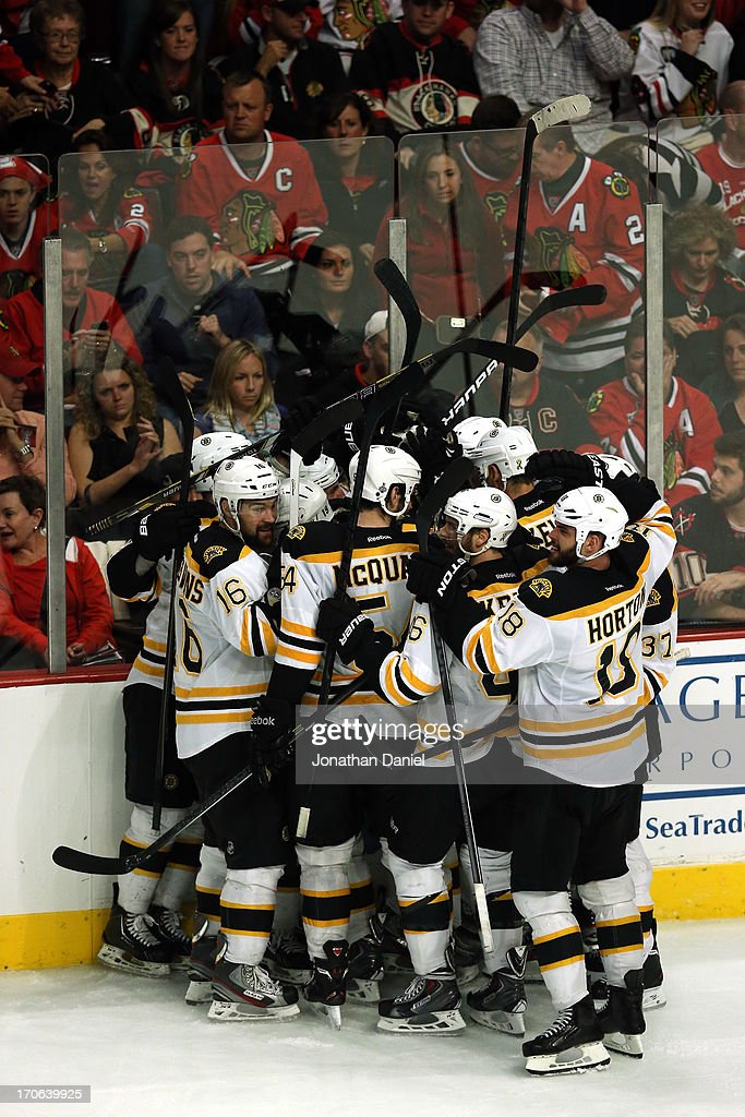 The Boston Bruins celebrate after Daniel Paille #20 scored the game-winning goal in overtime to give the Bruins a 2-1 win against the Chicago Blackhawks in Game Two of the NHL 2013 Stanley Cup Final at United Center on June 15, 2013 in Chicago, Illinois.