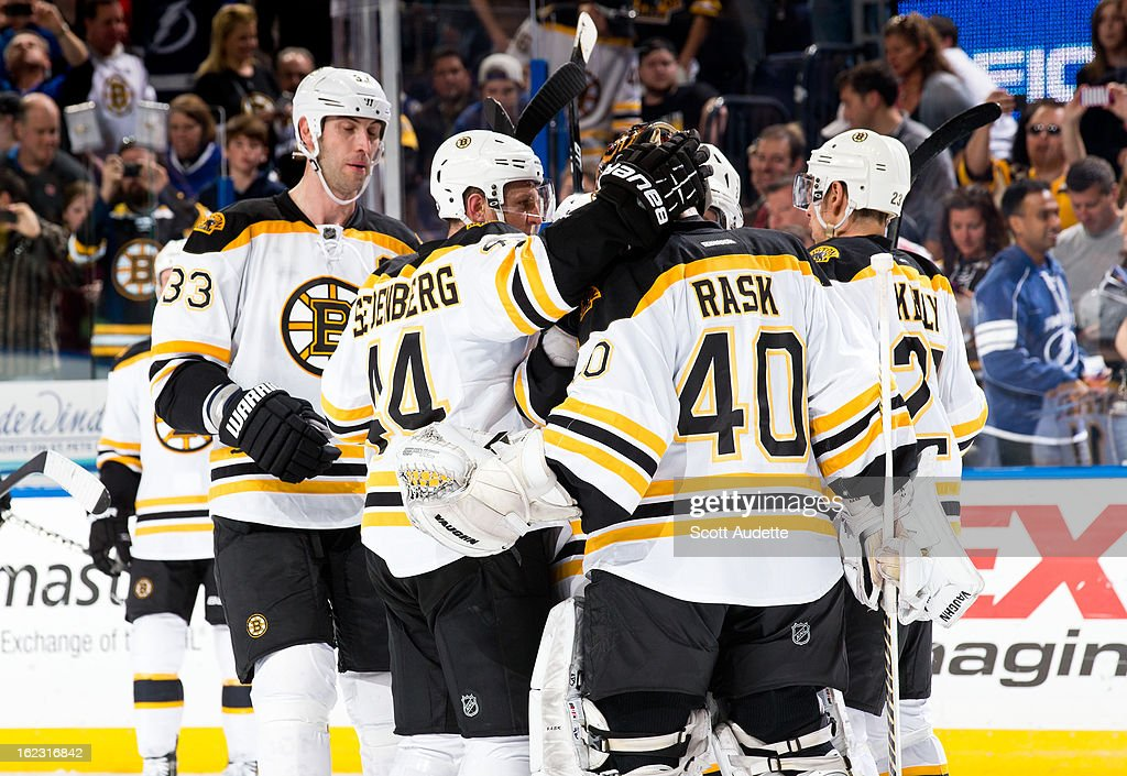 The Boston Bruins celebrate after defeating the Tampa Bay Lightning 4-2 at the Tampa Bay Times Forum on February 21, 2013 in Tampa, Florida.